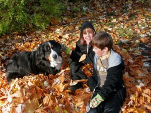 Molly & grandkids playing in leaves